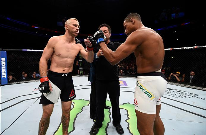 PITTSBURGH, PA - FEBRUARY 21:  (L-R) Donald Cerrone and Alex Oliveira touch gloves in their welterweight bout during the UFC Fight Night event at Consol Energy Center on February 21, 2016 in Pittsburgh, Pennsylvania. (Photo by Jeff Bottari/Zuffa LLC/Zuffa