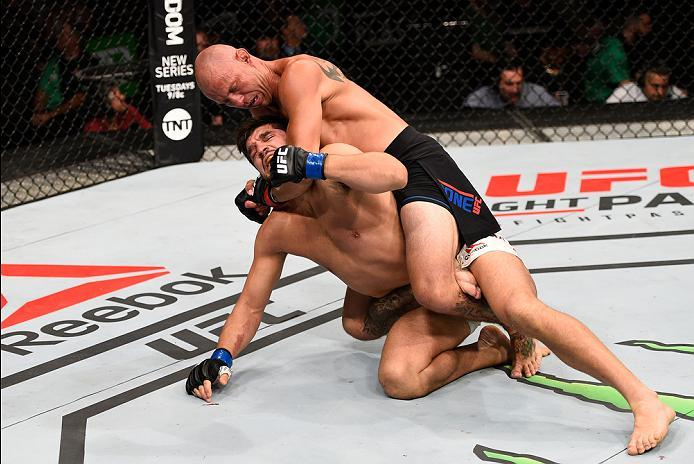 OTTAWA, ON - JUNE 18:   Donald Cerrone (top) of the United States attempts to submit Patrick Cote of Canada in their welterweight bout during the UFC Fight Night event inside the TD Place Arena on June 18, 2016 in Ottawa, Ontario, Canada. (Photo by Jeff B