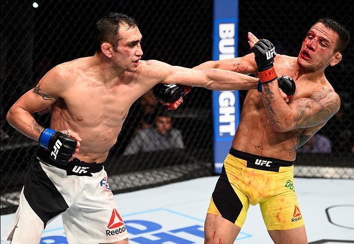 MEXICO CITY, MEXICO - NOVEMBER 05:  (L-R) Tony Ferguson of the United States punches Rafael Dos Anjos of Brazil in their lightweight bout during the UFC Fight Night event at Arena Ciudad de Mexico on November 5, 2016 in Mexico City, Mexico. (Photo by Jeff