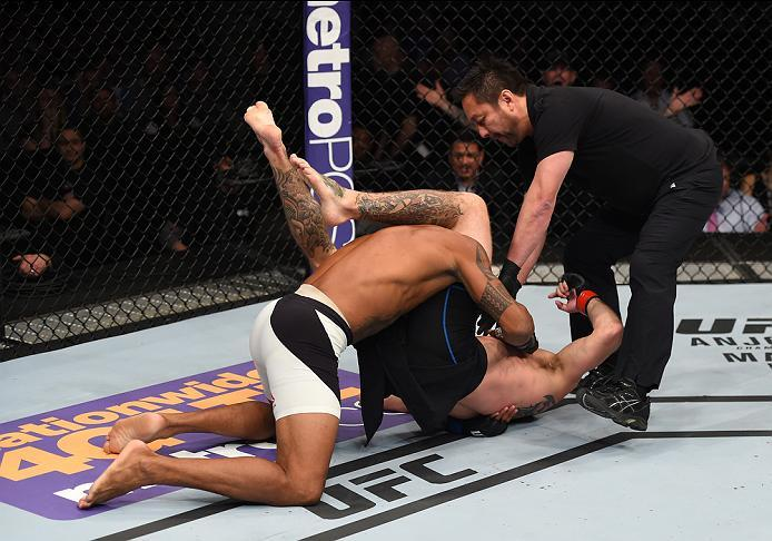 PITTSBURGH, PA - FEBRUARY 21:  Donald Cerrone submits Alex Oliveira in their welterweight bout during the UFC Fight Night event at Consol Energy Center on February 21, 2016 in Pittsburgh, Pennsylvania. (Photo by Jeff Bottari/Zuffa LLC/Zuffa LLC via Getty