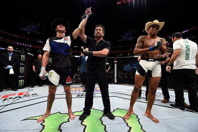 PITTSBURGH, PA - FEBRUARY 21:  (L-R) Donald Cerrone celebrates his submission victory over Alex Oliveira in their welterweight bout during the UFC Fight Night event at Consol Energy Center on February 21, 2016 in Pittsburgh, Pennsylvania. (Photo by Jeff B