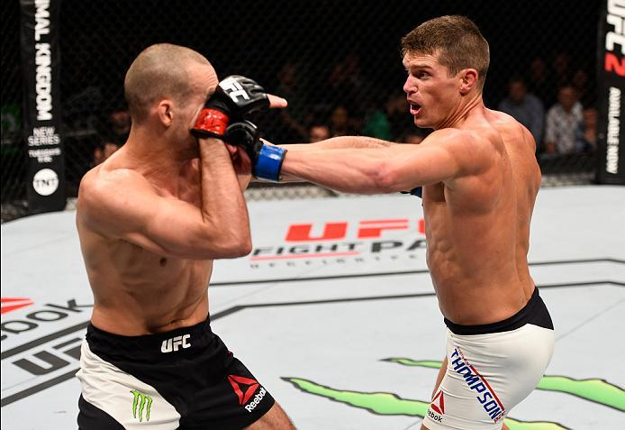 OTTAWA, ON - JUNE 18:   (R-L) Stephen Thompson of the United States punches Rory MacDonald of Canada in their welterweight bout during the UFC Fight Night event inside the TD Place Arena on June 18, 2016 in Ottawa, Ontario, Canada. (Photo by Jeff Bottari/