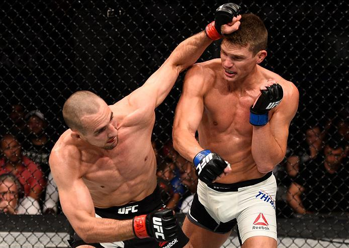 OTTAWA, ON - JUNE 18:   (L-R) Rory MacDonald of Canada exchanges punches with Stephen Thompson of the United States in their welterweight bout during the UFC Fight Night event inside the TD Place Arena on June 18, 2016 in Ottawa, Ontario, Canada. (Photo b