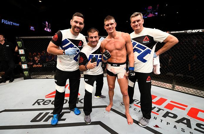 OTTAWA, ON - JUNE 18:   Stephen Thompson of the United States takes a picture with his team and celebrates his victory over Rory MacDonald of Canada in their welterweight bout during the UFC Fight Night event inside the TD Place Arena on June 18, 2016 in