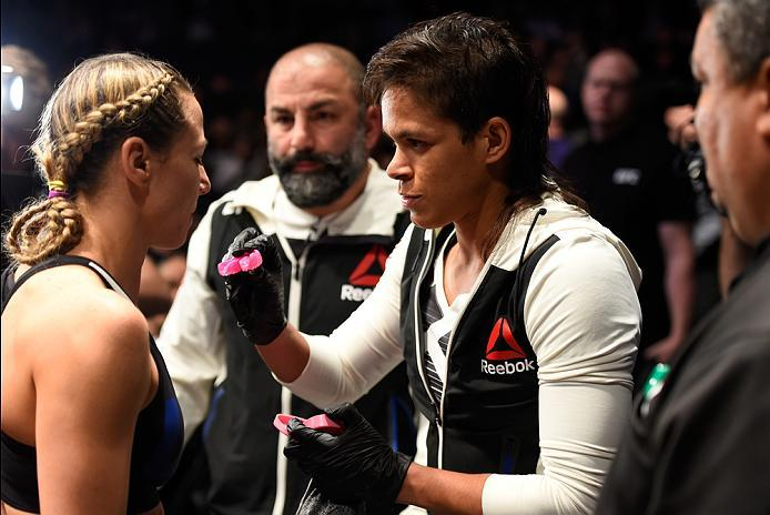 PHOENIX, AZ - JANUARY 15:  (L-R) Nina Ansaroff gets her mouthpiece from Amanda Nunes in their women's strawweight bout during the UFC Fight Night event inside Talking Stick Resort Arena on January 15, 2017 in Phoenix, Arizona. (Photo by Jeff Bottari/Zuffa