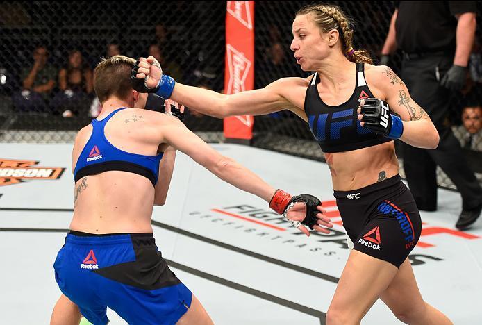 PHOENIX, AZ - JANUARY 15:  (R-L) Nina Ansaroff punches Jocelyn Jones-Lybarger in their women's strawweight bout during the UFC Fight Night event inside Talking Stick Resort Arena on January 15, 2017 in Phoenix, Arizona. (Photo by Jeff Bottari/Zuffa LLC/Zu