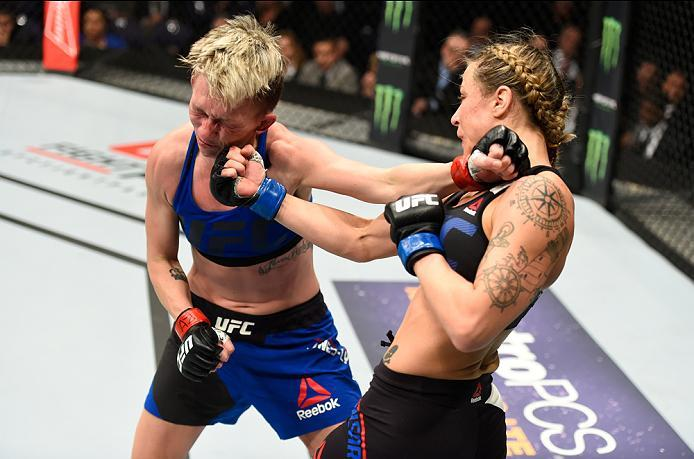 PHOENIX, AZ - JANUARY 15:  (R-L) Nina Ansaroff punches Jocelyn Jones-Lybarger in their women's strawweight bout during the UFC Fight Night event inside Talking Stick Resort Arena on January 15, 2017 in Phoenix, Arizona. (Photo by Jeff Bottari/Zuffa LLC/Zu