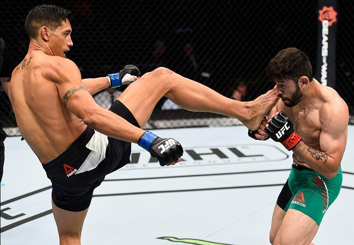 MEXICO CITY, MEXICO - NOVEMBER 05:  (L-R) Jason Novelli of the United States kicks Marco Polo Reyes of Mexico in their lightweight bout during the UFC Fight Night event at Arena Ciudad de Mexico on November 5, 2016 in Mexico City, Mexico. (Photo by Jeff B