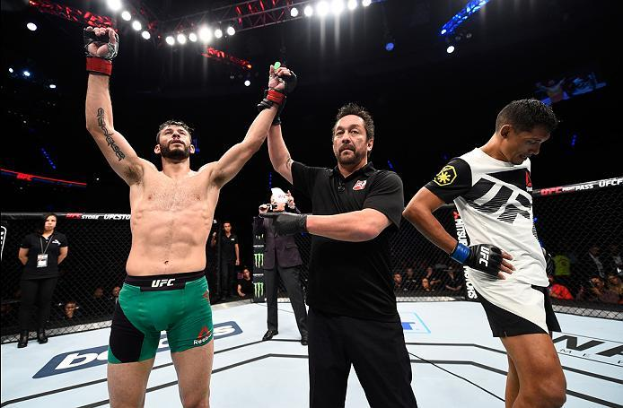 MEXICO CITY, MEXICO - NOVEMBER 05:  (L-R) Marco Polo Reyes of Mexico celebrates his victory over Jason Novelli of the United States in their lightweight bout during the UFC Fight Night event at Arena Ciudad de Mexico on November 5, 2016 in Mexico City, Me