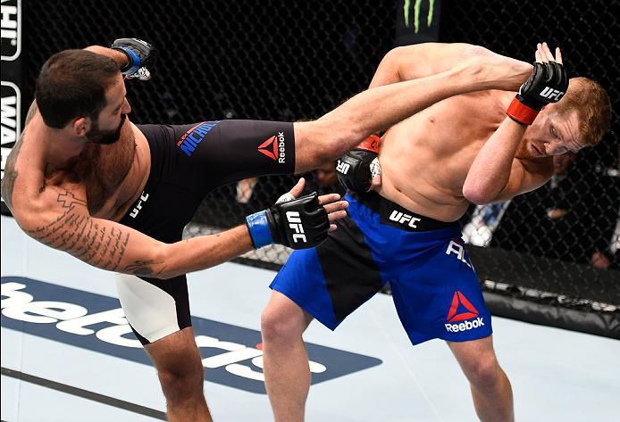 MEXICO CITY, MEXICO - NOVEMBER 05:  (L-R) Alex Nicholson of the United States kicks Sam Alvey of the United States in their middleweight bout during the UFC Fight Night event at Arena Ciudad de Mexico on November 5, 2016 in Mexico City, Mexico. (Photo by