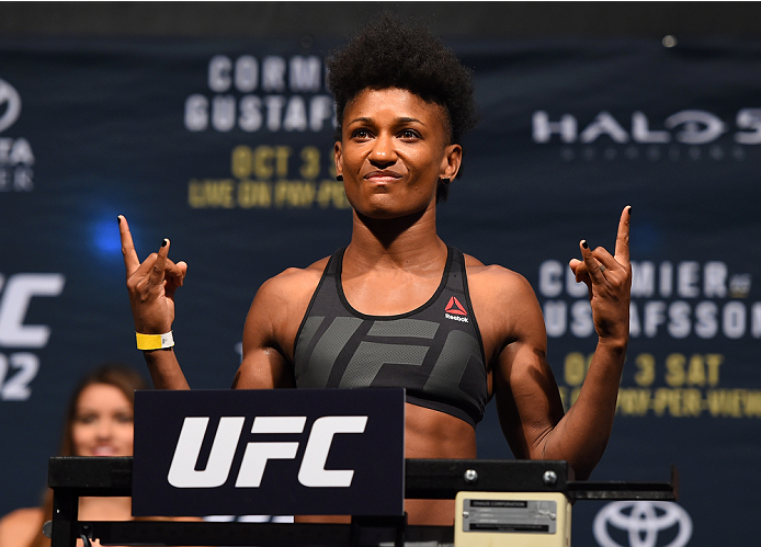 HOUSTON, TX - OCTOBER 02:  Angela Hill steps on the scale during the UFC 192 weigh-in at the Toyota Center on October 2, 2015 in Houston, Texas. (Photo by Josh Hedges/Zuffa LLC/Zuffa LLC via Getty Images)