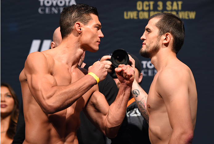 HOUSTON, TX - OCTOBER 02:  (L-R) Alan Jouban and Albert Tumenov face off during the UFC 192 weigh-in at the Toyota Center on October 2, 2015 in Houston, Texas. (Photo by Josh Hedges/Zuffa LLC/Zuffa LLC via Getty Images)