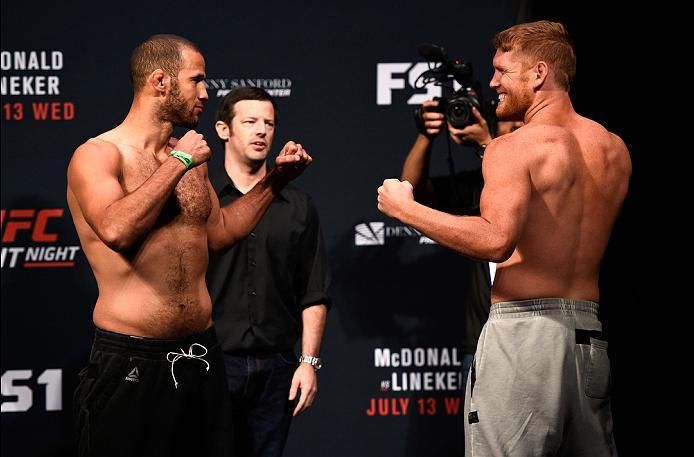 SIOUX FALLS, SD - JULY 12:   (L-R) Opponents Eric Spicely and Sam Alvey face off during the UFC Fight Night weigh-in at Denny Sanford Premier Center on July 12, 2016 in Sioux Falls, South Dakota. (Photo by Jeff Bottari/Zuffa LLC/Zuffa LLC via Getty Images