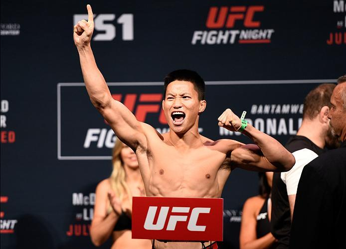 SIOUX FALLS, SD - JULY 12:   Ben Nguyen steps onto the scale during the UFC Fight Night weigh-in at Denny Sanford Premier Center on July 12, 2016 in Sioux Falls, South Dakota. (Photo by Jeff Bottari/Zuffa LLC/Zuffa LLC via Getty Images)