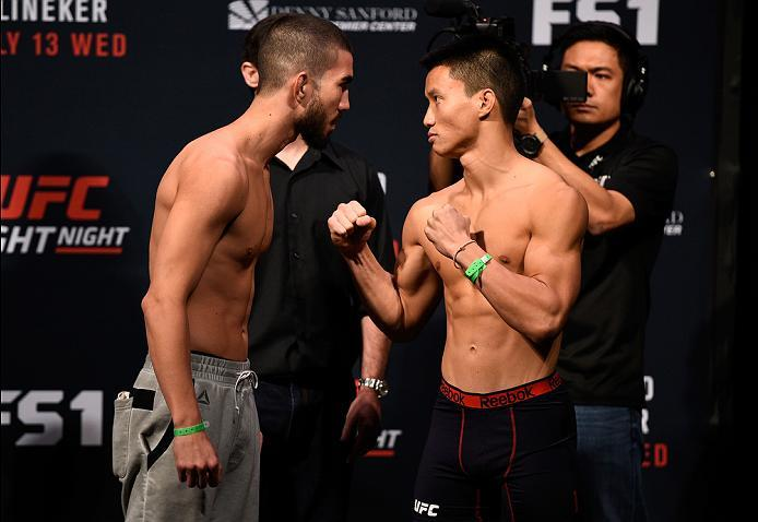 SIOUX FALLS, SD - JULY 12:   (L-R) Louis Smolka and Ben Nguyen face off during the UFC Fight Night weigh-in at Denny Sanford Premier Center on July 12, 2016 in Sioux Falls, South Dakota. (Photo by Jeff Bottari/Zuffa LLC/Zuffa LLC via Getty Images)