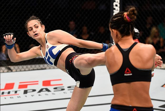 SIOUX FALLS, SD - JULY 13:   (L-R) Cristina Stanciu of Romania kicks Courtney Casey in their women's strawweight bout during the UFC Fight Night event on July 13, 2016 at Denny Sanford Premier Center in Sioux Falls, South Dakota. (Photo by Jeff Bottari/Zu