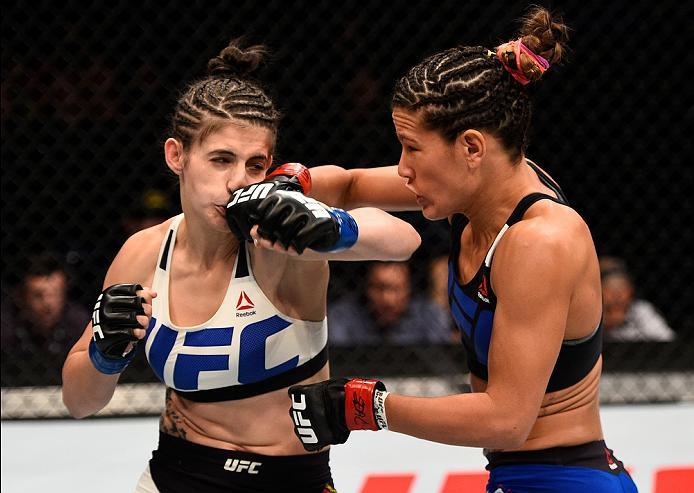 SIOUX FALLS, SD - JULY 13:   (R-L) Courtney Casey punches Cristina Stanciu of Romania in their women's strawweight bout during the UFC Fight Night event on July 13, 2016 at Denny Sanford Premier Center in Sioux Falls, South Dakota. (Photo by Jeff Bottari/