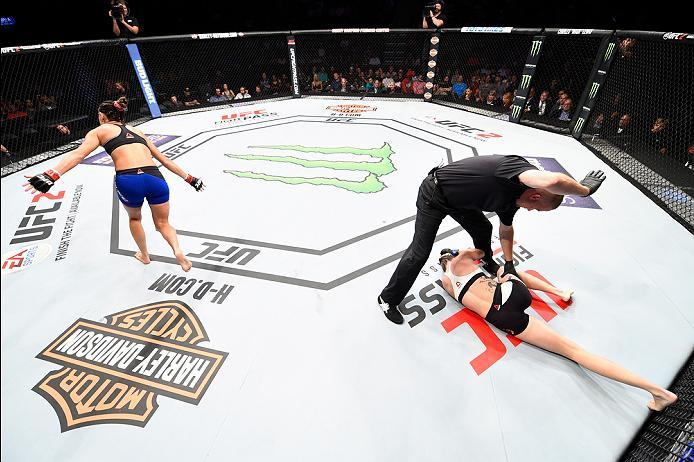 SIOUX FALLS, SD - JULY 13:   Courtney Casey (L) reacts after her TKO victory over Cristina Stanciu of Romania in their women's strawweight bout during the UFC Fight Night event on July 13, 2016 at Denny Sanford Premier Center in Sioux Falls, South Dakota.