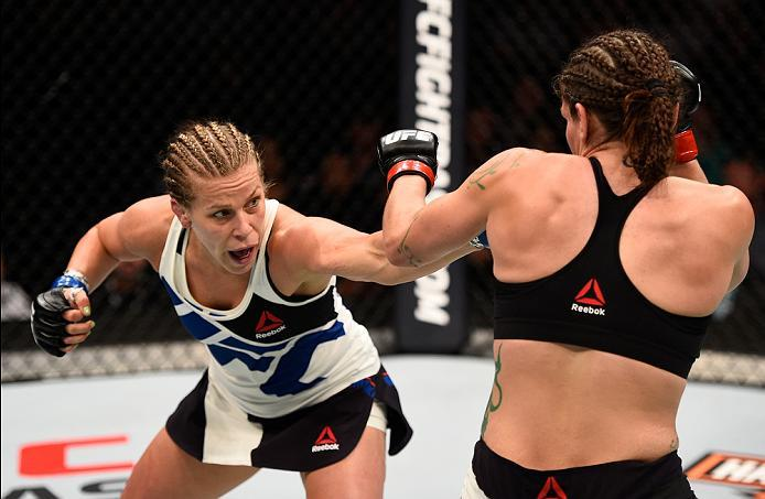 SIOUX FALLS, SD - JULY 13:   (L-R) Katlyn Chookagian punches Lauren Murphy in their women's bantamweight bout during the UFC Fight Night event on July 13, 2016 at Denny Sanford Premier Center in Sioux Falls, South Dakota. (Photo by Jeff Bottari/Zuffa LLC/