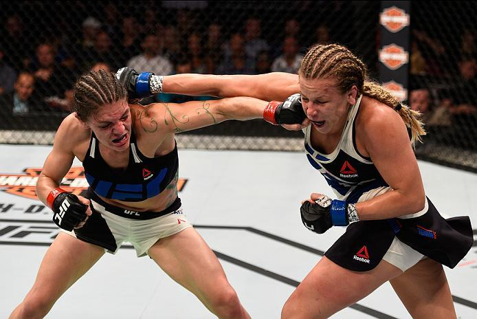 SIOUX FALLS, SD - JULY 13:   (L-R) Lauren Murphy  punches Katlyn Chookagian in their women's bantamweight bout during the UFC Fight Night event on July 13, 2016 at Denny Sanford Premier Center in Sioux Falls, South Dakota. (Photo by Jeff Bottari/Zuffa LLC
