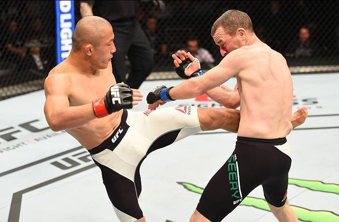 ROTTERDAM, NETHERLANDS - MAY 08:  (L-R) Kyoji Horiguchi kicks Neil Seery in their flyweight bout during the UFC Fight Night event at Ahoy Rotterdam on May 8, 2016 in Rotterdam, Netherlands. (Photo by Josh Hedges/Zuffa LLC/Zuffa LLC via Getty Images)