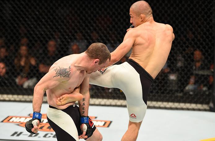 ROTTERDAM, NETHERLANDS - MAY 08:  (R-L) Kyoji Horiguchi kicks Neil Seery in their flyweight bout during the UFC Fight Night event at Ahoy Rotterdam on May 8, 2016 in Rotterdam, Netherlands. (Photo by Josh Hedges/Zuffa LLC/Zuffa LLC via Getty Images)