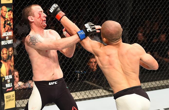 ROTTERDAM, NETHERLANDS - MAY 08:  (R-L) Kyoji Horiguchi punches Neil Seery in their flyweight bout during the UFC Fight Night event at Ahoy Rotterdam on May 8, 2016 in Rotterdam, Netherlands. (Photo by Josh Hedges/Zuffa LLC/Zuffa LLC via Getty Images)
