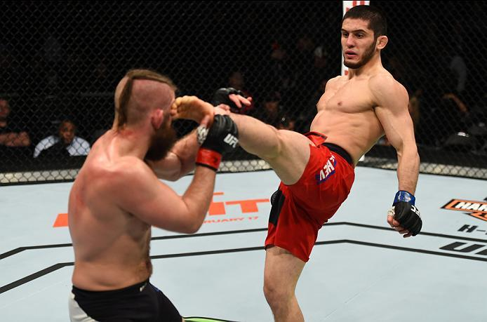 BROOKLYN, NEW YORK - FEBRUARY 11:  (R-L) Islam Makhachev of Russia kicks Nik Lentz in their lightweight bout during the UFC 208 event inside Barclays Center on February 11, 2017 in Brooklyn, New York. (Photo by Jeff Bottari/Zuffa LLC/Zuffa LLC via Getty I