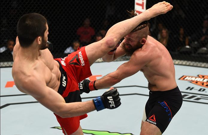 BROOKLYN, NEW YORK - FEBRUARY 11:  (L-R) Islam Makhachev of Russia kicks Nik Lentz in their lightweight bout during the UFC 208 event inside Barclays Center on February 11, 2017 in Brooklyn, New York. (Photo by Jeff Bottari/Zuffa LLC/Zuffa LLC via Getty I