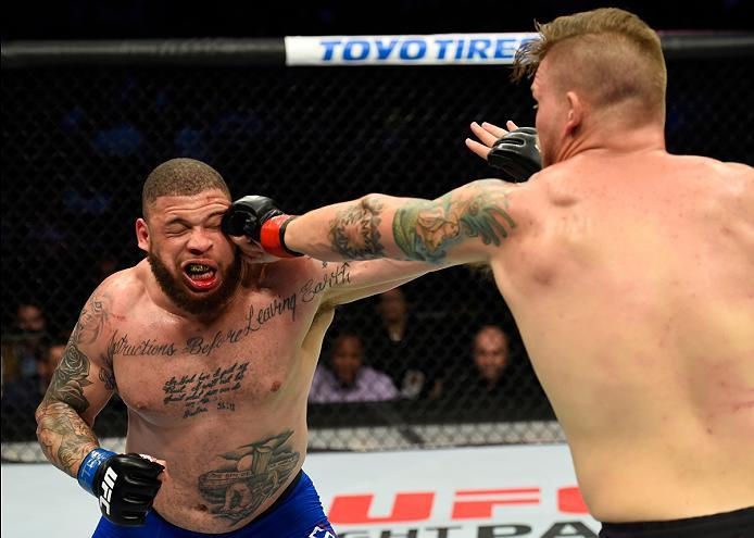 DALLAS, TX - MAY 13:  (R-L) Chase Sherman punches Rashad Coulter in their heavyweight fight during the UFC 211 event at the American Airlines Center on May 13, 2017 in Dallas, Texas. (Photo by Josh Hedges/Zuffa LLC/Zuffa LLC via Getty Images)