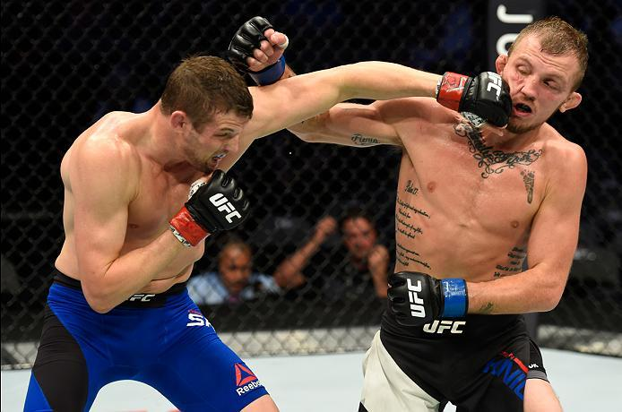 DALLAS, TX - MAY 13:  (L-R) Chas Skelly punches Jason Knight in their featherweight fight during the UFC 211 event at the American Airlines Center on May 13, 2017 in Dallas, Texas. (Photo by Josh Hedges/Zuffa LLC/Zuffa LLC via Getty Images)