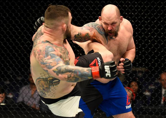 LONDON, ENGLAND - MARCH 18:  (L-R) Daniel Omielanczuk of Poland kicks Tim Johnson in their heavyweight fight during the UFC Fight Night event at The O2 arena on March 18, 2017 in London, England. (Photo by Josh Hedges/Zuffa LLC/Zuffa LLC via Getty Images)