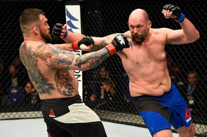 LONDON, ENGLAND - MARCH 18:  (R-L) Tim Johnson punches Daniel Omielanczuk of Poland in their heavyweight fight during the UFC Fight Night event at The O2 arena on March 18, 2017 in London, England. (Photo by Josh Hedges/Zuffa LLC/Zuffa LLC via Getty Image