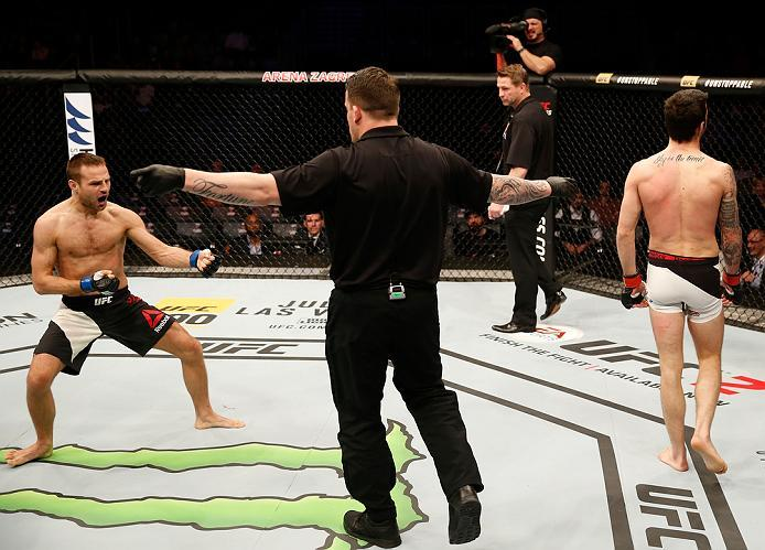 ZAGREB, CROATIA - APRIL 10:   (L-R) Damian Stasiakin celebrates his submission victory over Filip Pejic in their bantamweight bout during the UFC Fight Night event at the Arena Zagreb on April 10, 2016 in Zagreb, Croatia. (Photo by Srdjan Stevanovic/Zuffa