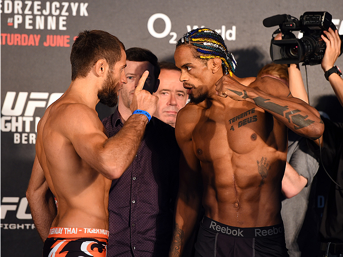 BERLIN, GERMANY - JUNE 19:   (L-R) Opponents Mairbek Taisumov of Russia and Alan Patrick of Brazil face off during the UFC Berlin weigh-in at the O2 World on June 19, 2015 in Berlin, Germany. (Photo by Josh Hedges/Zuffa LLC/Zuffa LLC via Getty Images)