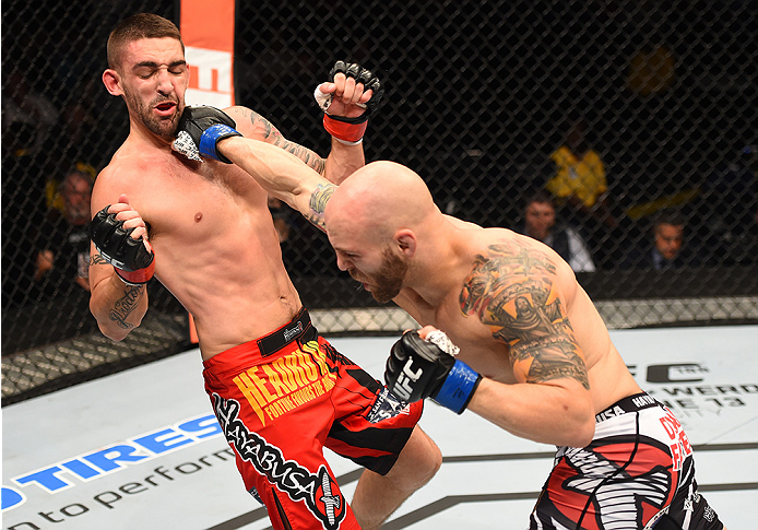 NEW ORLEANS, LA - JUNE 06:   (R-L) Justin Edwards punches Joe Proctor in their lightweight bout during the UFC event at the Smoothie King Center on June 6, 2015 in New Orleans, Louisiana. (Photo by Josh Hedges/Zuffa LLC/Zuffa LLC via Getty Images)