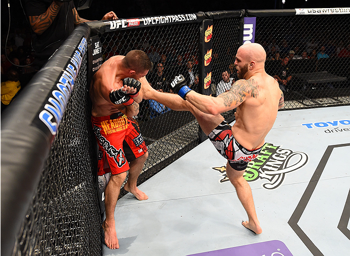 NEW ORLEANS, LA - JUNE 06:   (R-L) Justin Edwards kicks Joe Proctor in their lightweight bout during the UFC event at the Smoothie King Center on June 6, 2015 in New Orleans, Louisiana. (Photo by Josh Hedges/Zuffa LLC/Zuffa LLC via Getty Images)