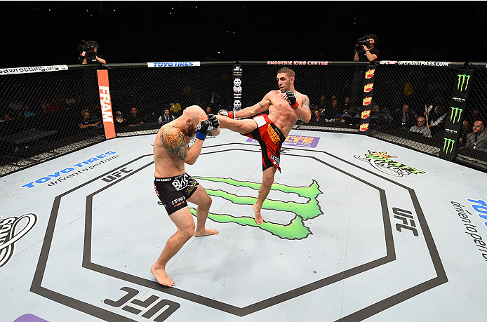 NEW ORLEANS, LA - JUNE 06:   (R-L) Joe Proctor kicks Justin Edwards in their lightweight bout during the UFC event at the Smoothie King Center on June 6, 2015 in New Orleans, Louisiana. (Photo by Josh Hedges/Zuffa LLC/Zuffa LLC via Getty Images)