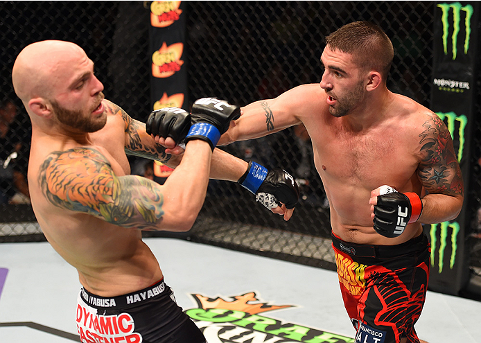 NEW ORLEANS, LA - JUNE 06:   (R-L) Joe Proctor punches Justin Edwards in their lightweight bout during the UFC event at the Smoothie King Center on June 6, 2015 in New Orleans, Louisiana. (Photo by Josh Hedges/Zuffa LLC/Zuffa LLC via Getty Images)