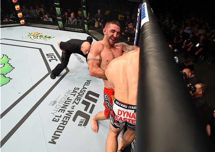 NEW ORLEANS, LA - JUNE 06:   (L-R) Joe Proctor attempts to submit Justin Edwards in their lightweight bout during the UFC event at the Smoothie King Center on June 6, 2015 in New Orleans, Louisiana. (Photo by Josh Hedges/Zuffa LLC/Zuffa LLC via Getty Imag