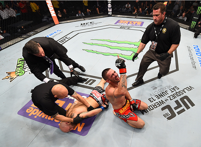 NEW ORLEANS, LA - JUNE 06:   (R-L) Joe Proctor celebrates his submission victory over Justin Edwards in their lightweight bout during the UFC event at the Smoothie King Center on June 6, 2015 in New Orleans, Louisiana. (Photo by Josh Hedges/Zuffa LLC/Zuff