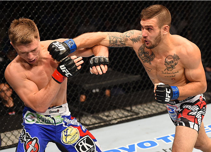 NEW ORLEANS, LA - JUNE 06:   (R-L) Christos Giagos punches Chris Wade in their lightweight bout during the UFC event at the Smoothie King Center on June 6, 2015 in New Orleans, Louisiana. (Photo by Josh Hedges/Zuffa LLC/Zuffa LLC via Getty Images)