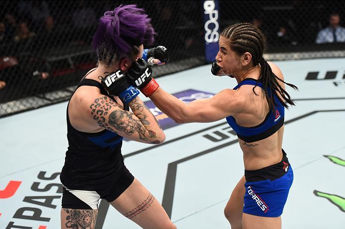 HOUSTON, TX - FEBRUARY 04:  (R-L) Tecia Torres punches Bec Rawlings of Australia in their women's strawweight bout during the UFC Fight Night event at the Toyota Center on February 4, 2017 in Houston, Texas. (Photo by Jeff Bottari/Zuffa LLC/Zuffa LLC via