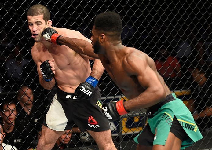KANSAS CITY, MO - APRIL 15:  (R-L) Aljamain Sterling punches Augusto Mendes of Brazil in their bantamweight fight during the UFC Fight Night event at Sprint Center on April 15, 2017 in Kansas City, Missouri. (Photo by Josh Hedges/Zuffa LLC/Zuffa LLC via G