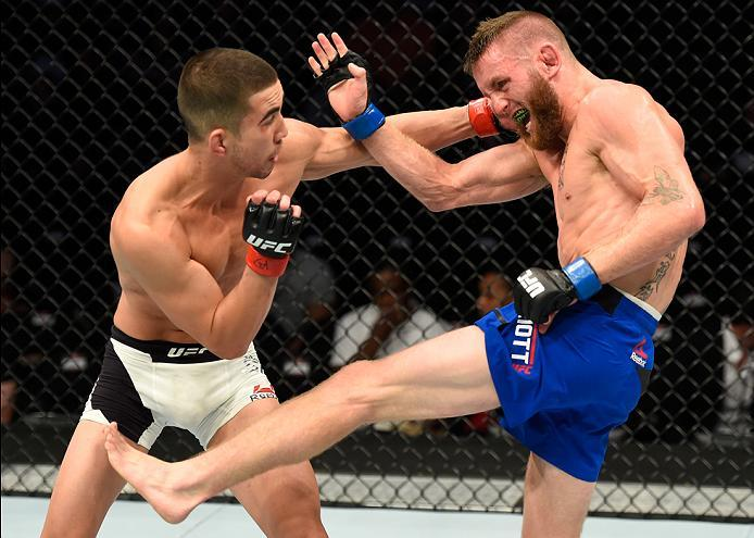 KANSAS CITY, MO - APRIL 15:  (L-R) Louis Smolka punches Tim Elliott in their flyweight fight during the UFC Fight Night event at Sprint Center on April 15, 2017 in Kansas City, Missouri. (Photo by Josh Hedges/Zuffa LLC/Zuffa LLC via Getty Images)