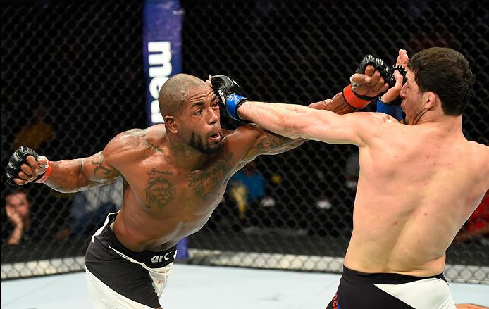 KANSAS CITY, MO - APRIL 15:  (L-R) Bobby Green punches Rashid Magomedov of Russia in their lightweight fight during the UFC Fight Night event at Sprint Center on April 15, 2017 in Kansas City, Missouri. (Photo by Josh Hedges/Zuffa LLC/Zuffa LLC via Getty