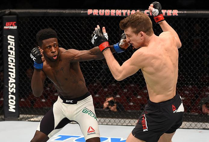 NEWARK, NJ - JANUARY 30:  (L-R) Randy Brown punches Matt Dwyer in their welterweight bout during the UFC Fight Night event at the Prudential Center on January 30, 2016 in Newark, New Jersey. (Photo by Josh Hedges/Zuffa LLC/Zuffa LLC via Getty Images)