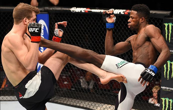 NEWARK, NJ - JANUARY 30:  (R-L) Randy Brown kicks Matt Dwyer in their welterweight bout during the UFC Fight Night event at the Prudential Center on January 30, 2016 in Newark, New Jersey. (Photo by Josh Hedges/Zuffa LLC/Zuffa LLC via Getty Images)