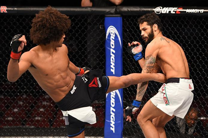 NEWARK, NJ - JANUARY 30:  (L-R) Alex Caceres kicks Masio Fullen in their featherweight bout during the UFC Fight Night event at the Prudential Center on January 30, 2016 in Newark, New Jersey. (Photo by Ed Mulholland/Zuffa LLC/Zuffa LLC via Getty Images)