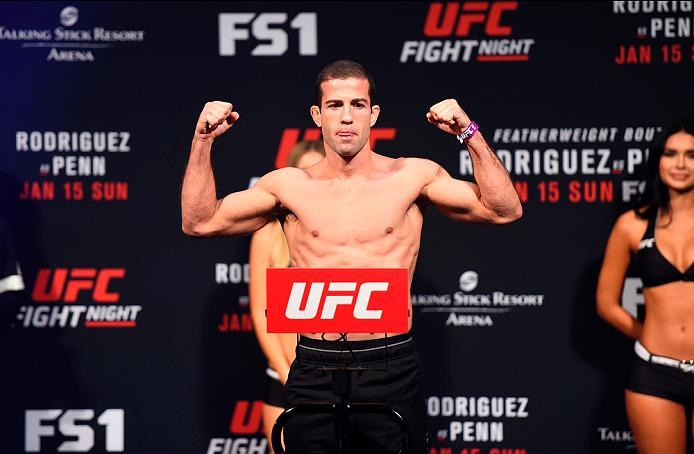 PHOENIX, ARIZONA - JANUARY 14:  Augusto Mendes of Brazil steps on the scale during the UFC Fight Night weigh-in at the Talking Stick Resort Arena on January 14, 2017 in Phoenix, Arizona. (Photo by Jeff Bottari/Zuffa LLC/Zuffa LLC via Getty Images)